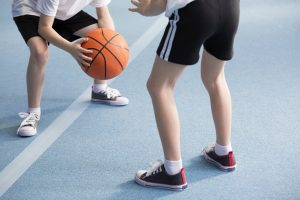 Pupils playing basketball